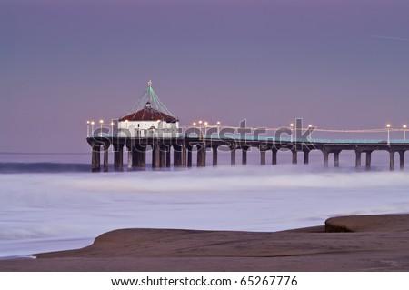 Manhattan Beach Pier Long Exposure Large Surf Dawn - stock photo