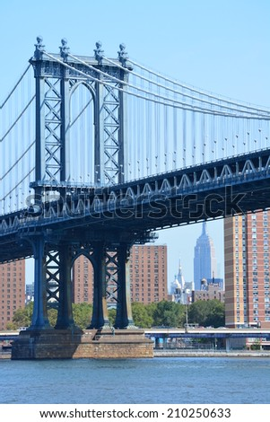 Manhattan Bridge along the East river with the Empire State Building in the background. - stock photo