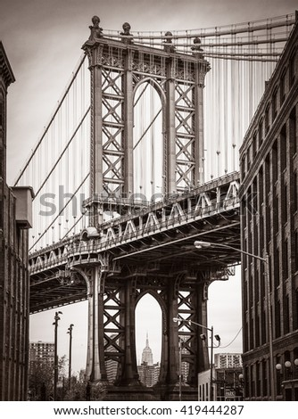 Manhattan Bridge and Empire State Building seen from Brooklyn, New York. Old photo stylization, film grain added. Sepia toned - stock photo
