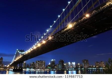 Manhattan Bridge and skyline At Night, New York City - stock photo