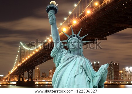 manhattan Bridge and The Statue of Liberty at Night, New York City - stock photo