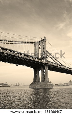 Manhattan Bridge black and white over East River viewed from New York City Lower Manhattan waterfront at sunset. - stock photo