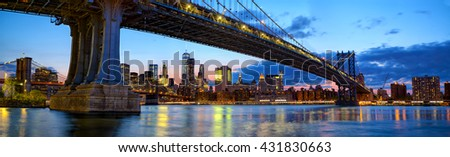Manhattan Bridge panorama with skyline and Brooklyn Bridge at dusk, New York - stock photo