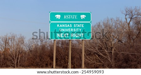 MANHATTAN, KS - FEBRUARY 8: A road sign for Kansas State University in Manhattan, Kansas on February 8, 2015. Kansas State University is a public research university established in 1863. - stock photo