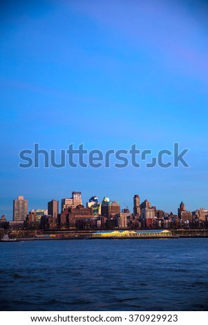 Manhattan Midtown skyline at dusk over Hudson River, New York City - stock photo