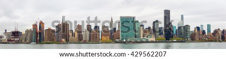 Manhattan, New York City. Panoramic view of Midtown skyline and the United Nations headquarters. View from Queens over the East River - stock photo