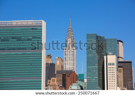 Manhattan New York sunny skyline East River NYC USA - stock photo