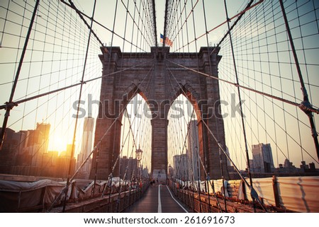 Manhattan, New York, United States - 12 August 2015 : Brooklyn bridge at sunset in New York
