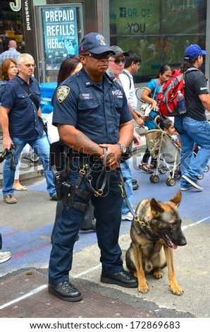 MANHATTAN, NY- SEPTEMBER 21: Cop at Manhattan Time Square and transportation in New York, USA on September 21, 2013. One of the 5 boroughs of New York City, the smallest but also the most populated. - stock photo