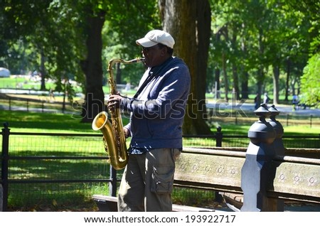 MANHATTAN, NY- SEPTEMBER 21: Performer at Central Park in New York, USA on September 21, 2013. One of the 5 boroughs of New York City, the smallest but also the most populated. - stock photo