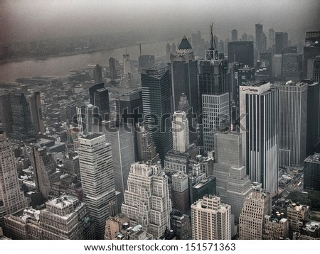 Manhattan, NYC. Wonderful skyline aerial view on a foggy day. - stock photo