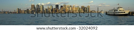 Manhattan panorama photo, white passenger boat in foreground, photograph taken from New Jersey - stock photo