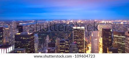 Manhattan skyline and Central Park panoramic at night - stock photo
