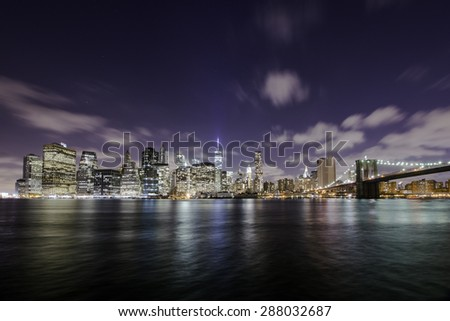 Manhattan skyline at night over the Hudson river, New York City - stock photo