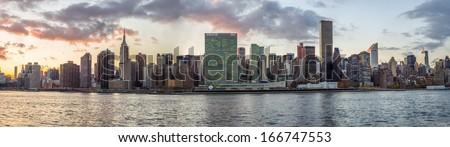 Manhattan Skyline in New York City at Sunset - stock photo