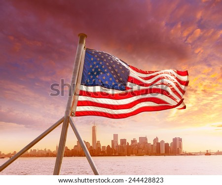Manhattan skyline New York with American flag US USA - stock photo