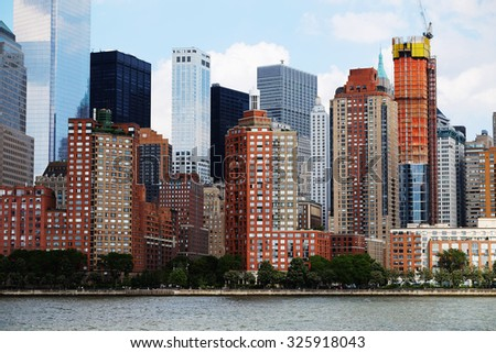 Manhattan skyline over Hudson River, New York, USA. Manhattan downtown view with skyscrapers, NYC panorama. Top of the buildings in financial district. Business background. - stock photo