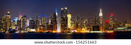 Manhattan skyline panorama with Times Square lights at night, New York City - stock photo