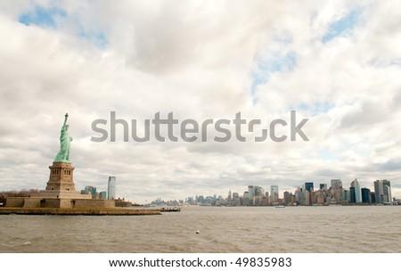 Manhattan Skyline, Statue of Liberty and Hudson river - stock photo