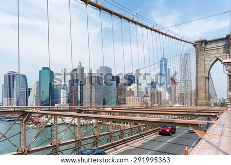 Manhattan Skyline through Brooklyn Bridge, New York City - stock photo