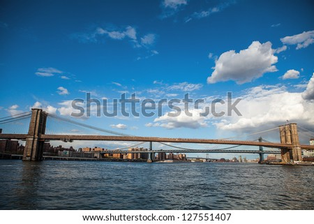 Manhattan skyline with Bridge over East River, New York - stock photo