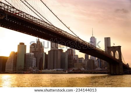 Manhattan skyline with Brooklyn Bridge at sunset, New York City - stock photo