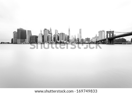 Manhattan Skyline with Brooklyn Bridge, New York City  - stock photo