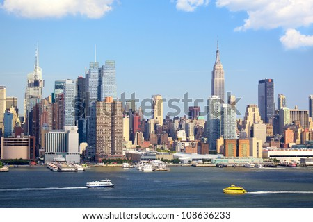 Manhattan Skyline with Empire State Building over Hudson River, New York City - stock photo