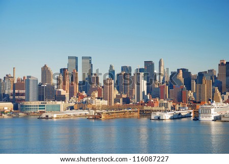 Manhattan urban City Skyline, New York City over Hudson River with boat and pier. - stock photo