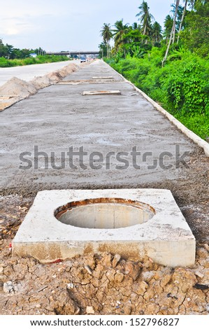 Manholes construction on the side walk - stock photo