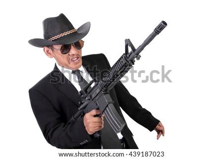 Maniacal expression of an old gangster in a battle, with his gun pointing up, isolated on white background - stock photo