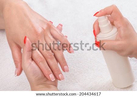 manicure applying - moisturising - stock photo