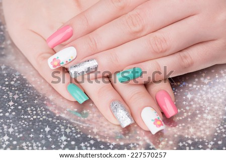Manicure - Beauty treatment photo of nice feminine manicured woman fingernails. Selective focus. - stock photo