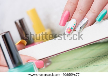 Manicure - Beauty treatment photo of nice feminine manicured woman fingernails. Selective focus. - stock photo