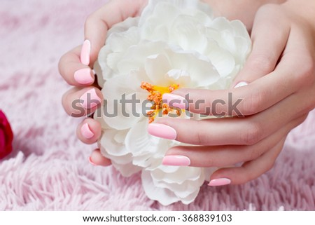 Manicure - Beauty treatment photo of nice manicured woman fingernails . Feminine nail art with nice glitter, pink and white nail polish. - stock photo
