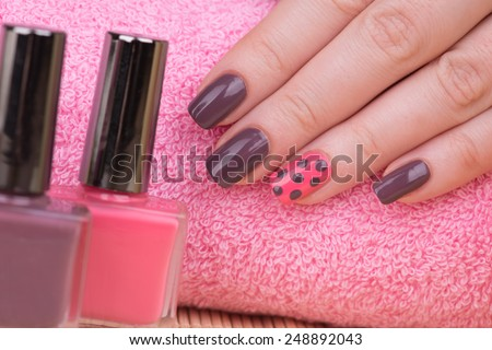 Manicure - Beauty treatment photo of nice manicured woman fingernails. Very nice feminine nail art with nice pink and purple nail polish. - stock photo