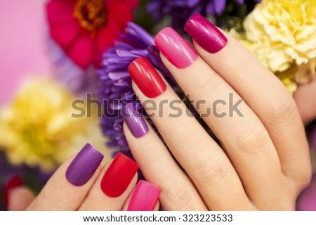 Manicure covered with nail Polish in the colors of nature. shallow dof - stock photo