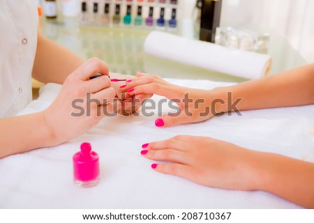 manicure, girl doing manicure in beauty salon - stock photo