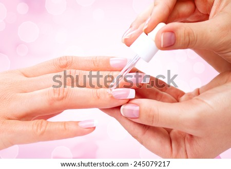 Manicure, Hands spa Cuticle oil. Beautiful Woman hands closeup. Manicured nails and Soft skin. Beauty hands. Beauty treatment. Beautiful woman's nails with beautiful french manicure  - stock photo