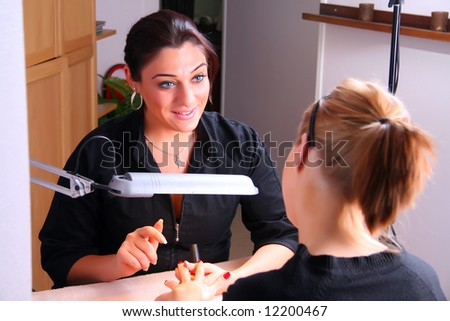 Manicure on female hands - stock photo
