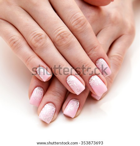 Manicure on long nails covered with roses lacquered - stock photo