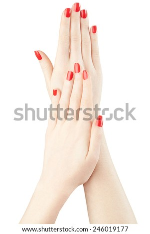 Manicure on woman hands with red nail polish isolated on white, clipping path included - stock photo