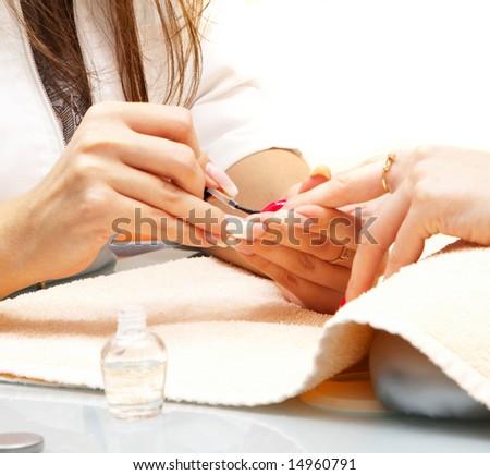 Manicure process... Female hands... - stock photo