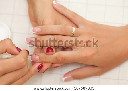 Manicure process in beautiful salon - stock photo