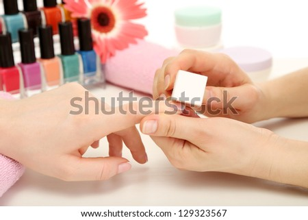 Manicure process in beauty salon, close up - stock photo