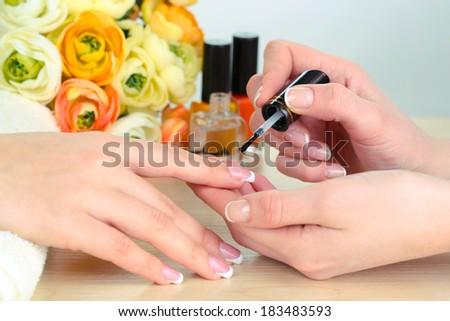Manicure process in beauty salon close up - stock photo