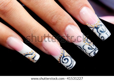 manicured acrylic nails on black background - stock photo