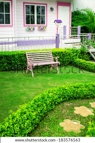Manicured House and Garden displaying annual and perennial  - stock photo