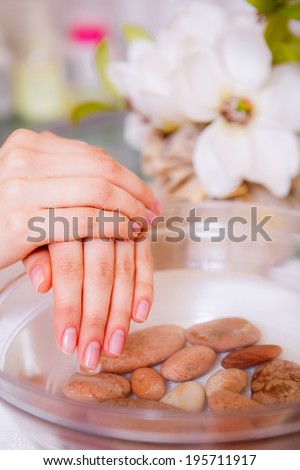 Manicures, spa treatments for hands, hand care, health and beauty of hands, the girl in a beauty salon, body care - stock photo