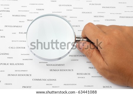 Manifying glass focus on blank paper suitable for  your own text. - stock photo